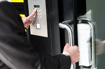 Man Securing His House in Wesley Chapel with an Access Control System