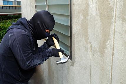 Burglar Robbing a Wesley Chapel House with No Alarm System