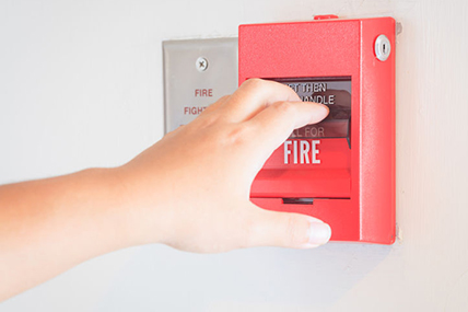 Business Owner Setting up Fire Alarm System in his Store in Wesley Chapel